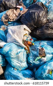 Piles of garbage in plastic bin (trash, waste) bags. Landfill. Close-up.