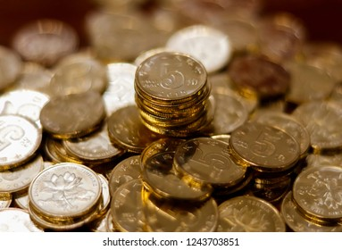 piles of golden Chinese coins on the table. The concept of wealth fund savings and financing.