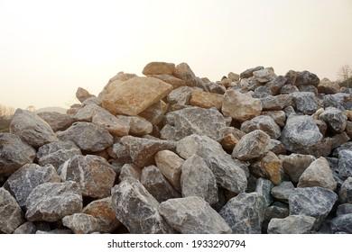 Piles of gravel limestone rocks on construction site. Break stones.