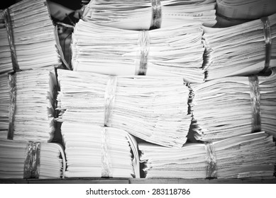 Piles of paper on the shelves