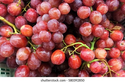 Piles of red grape on display for sale.