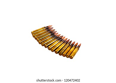 piles of rifle bullets on white