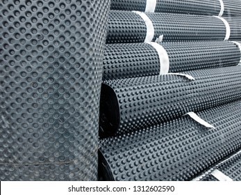 Piles of rolled membrane waterproofing tied with tape