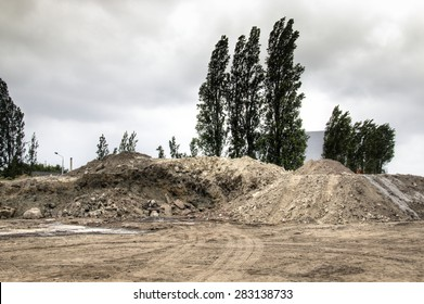 Piles of sand and dirt at construction works in the harbour of Antwerp, Belgium