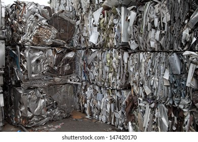 Piles of scrap metal bundled in cubes for recycling
