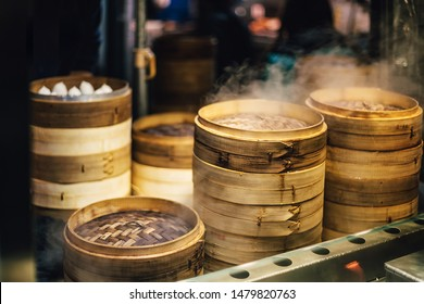 Piles of stacking bamboo steamers are steaming for dim sum. Street food of Jiantan in Taipei, Taiwan. Focus on front bamboo steamers.