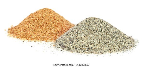 Piles of two colors sand for construciton over white background