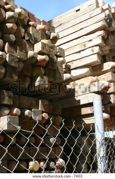 piles of wooden posts