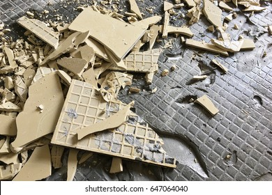 A pileup of broken ceramic tiles due to improper residential construction material. Can be use as textured background