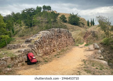 Pilgrim Backpack Leaning against the Ruins of the Roman Bridge outside Cirauqui along the Way of St James Pilgrim Trail Camino de Santiago