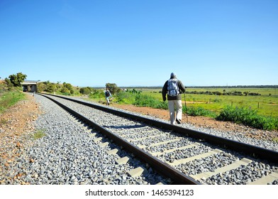 Pilgrim crossing the train tracks on the Via de la Plata between Torremejias and Mérida, province of Badajoz, Spain. Via de la Plata is the Camino de Santiago from Seville to Santiago de Compostela