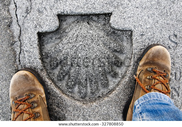 pilgrim feets with shell mark in Obradoiro Square, across from the cathedral of Compostela , Camino de Santiago , Way of st James