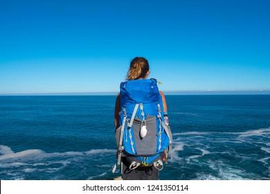 Pilgrim looking at the ocean on Camino Norte, Camino de Santiago in Spain.