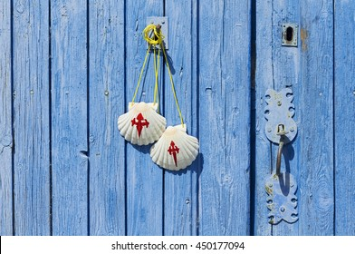 pilgrim scallops on antique wooden door , Way of St James,  Camino de  Santiago, to Compostela,Villarejo de Orbigo village, Leon, Spain