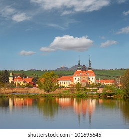 Pilgrimage Church Velehrad and castle Buchlov in background, Moravia, Czech Republic