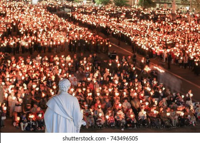 Pilgrimage to Lourdes. It happens every year in May. Soldiers from all over the world come to pray blessed Virgin Mary.