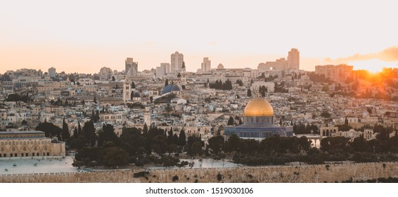 pilgrimage religion destination place Jerusalem old city panorama landmark view in evening sun set time with stone houses and gold dome