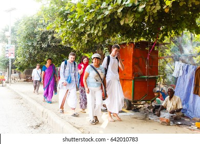 Pilgrims go parikrama around the holy hill of Govardhana.India, Govardhan, November 2016