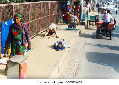 Pilgrims in Govardhana crawl parikramu.India, Govardhan, November 2016