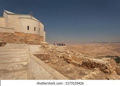 Pilgrims near Moses memorial church on Mt. Nebo looking to Mose's Promised Land, Madaba, Jordan