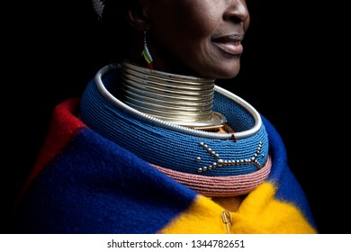 Pilgrims Rest, Mpumalanga, South Africa- July 12, 2011: An Ndebele woman poses for a portrait showing her traditional colourful clothes and intricate jewellery.