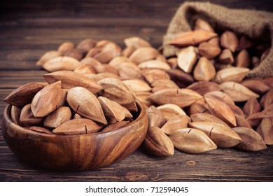 pili nuts on wooden background