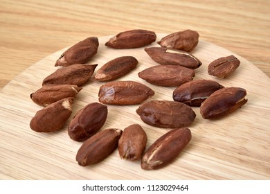 Pili nuts from the Philippines on wooden background