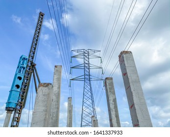Piling against transmission tower pylon electricity high voltage. Industrial and development concept.