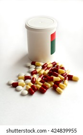 pill bottle and a heap of colorful scattered pills on white background, vertical