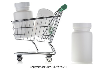 Pill bottle and pills in shopping cart isolated on white.  Concept. online store pharmacy