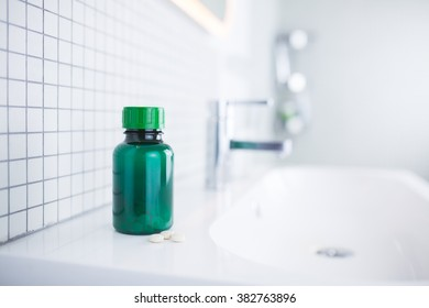 pill bottle standing in the bathroom