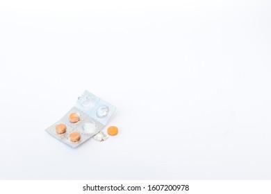 pill with pill strip beside it
