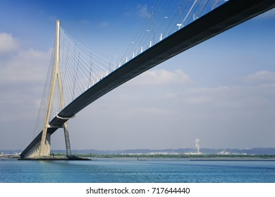 "pillar of the bridge ""Pont de Normandie"" reflected in the Seine river at Le Havre, France"