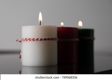 Pillar Candles In Dark Room Abstract Christmas Background. Selective Focus With Copy Space.