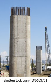 Pillar concrete under construction with reinforced steel rods or bars used to reinforce concrete.