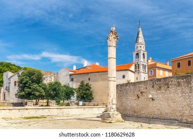 Pillar of Shame and Saint Elias church in historic center of Zadar town, Croatia, Europe.