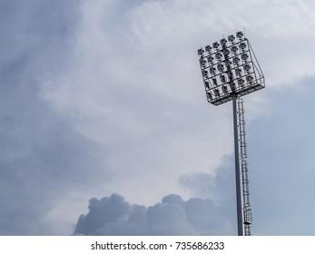 Pillar spotlights on blue sky background