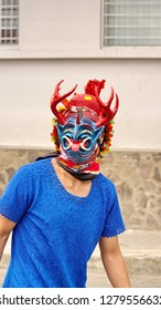 PILLARO, ECUADOR - JANUARY 3, 2018: Person in a devil mask and headdress at the Diablada, or Devil Festival