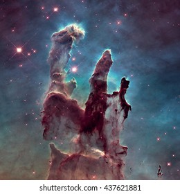 The Pillars of Creation. The Eagle Nebula (M16, NGC 6611) is a young open cluster of stars in the constellation Serpens. Retouched image with small DOF. Elements of this image furnished by NASA.