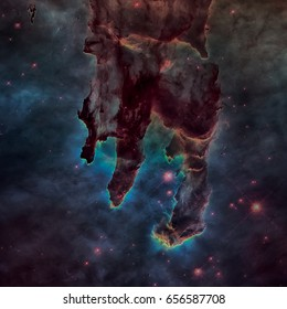 The Pillars of Creation. The Eagle Nebula or M16 or NGC 6611 is a young open cluster of stars in the constellation Serpens. Elements of this image furnished by NASA.