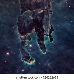 The Pillars of Creation. The Eagle Nebula or M16 or NGC 6611 is a young open cluster of stars in the constellation Serpens. Retouched image with small DOF. Elements of this image furnished by NASA.