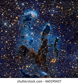 The Pillars of Creation. Infrared view of the Eagle Nebula (M16). It is a young open cluster of stars in the constellation Serpens. Retouched colored image. Elements of this image furnished by NASA.