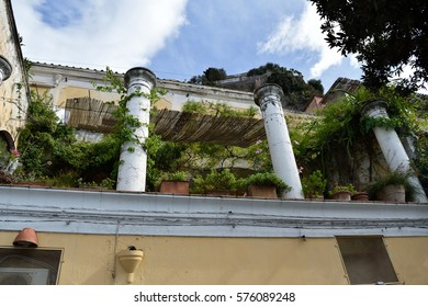 Pillars on a roof garden in Positano, Italy with many plants