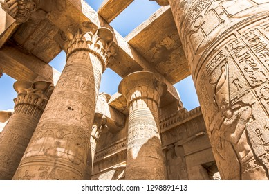 Pillars at the temple of Kom Ombo, decorated with hieroglyphics. The blue sky is seen through the ceiling, Egypt, October 23, 2018