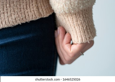 Pilled sweater. Closeup woman wearing a old used sweater with lint (pilling).