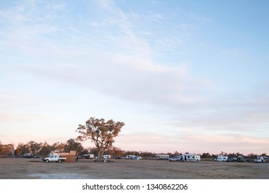 Pilliga, News South Wales/ Australia- July 21 2018: Caravans and campers at the Pilliga Bore Bath campground in New South Wales, Australia. A low-cost campground with an artesian bore pool.