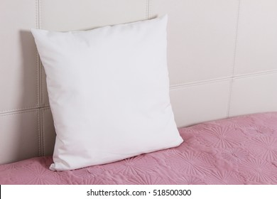 Pillow case Mockup. White cushion on bed in the bedroom. Perspective view.