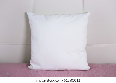 Pillow case Mockup. White cushion on bed in the bedroom. Front view.