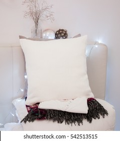 Pillow case Mockup. White cushion on bed in cozy bedroom. Holidays decorations.
