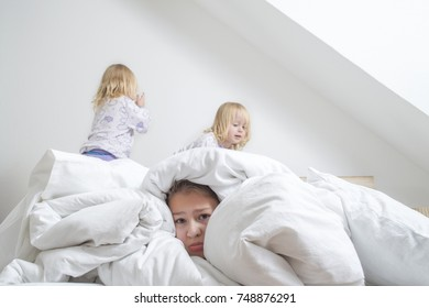 pillow fight, childrenPillow fight. Games with younger sisters. Nobody can find me. Happy weekend.